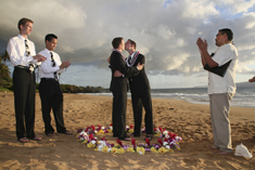 grooms standing in a flower circle at their maui beach wedding