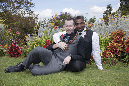 Two gay men at their Maui garden wedding in Hawaii