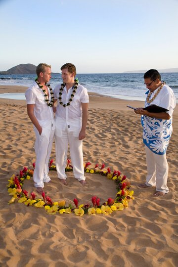 gay men holding hands at gay wedding on maui