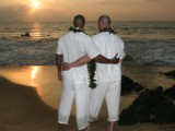 grooms looking out to the sunset