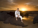 handsome groom at sunset on Maui beach