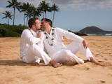 grooms kiss at their wedding in Hawaii
