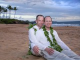 happy gay couple on the beach in Maui