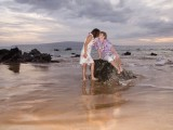 wedding photo of women kissing on rock