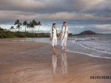 nice gay wedding on maui as two men walk on beach